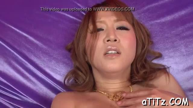 Huge hooters oriental masturbates with a meaty sex toy